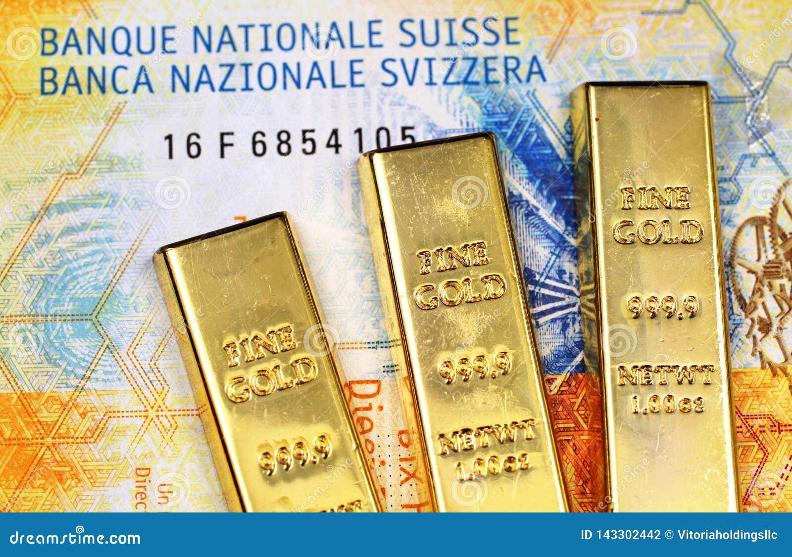 Tio schweizisk franc sedel med tre guld- stänger