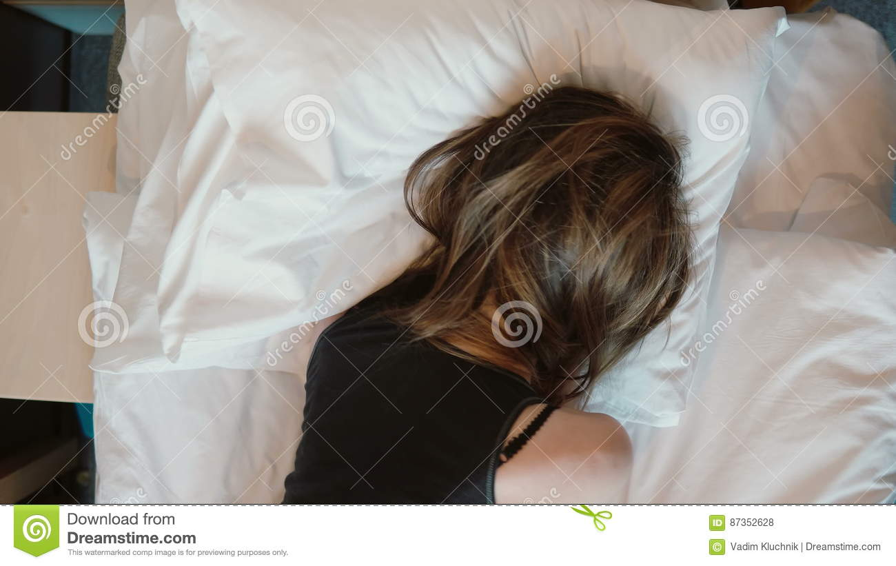 8c5fcbebe06d Tip View Of Depressed Young Woman Lying Face Down On The Bed. Crying Girl  Shaking Head And Pulling At Hair With Anger. Stock Footage - Video of fist