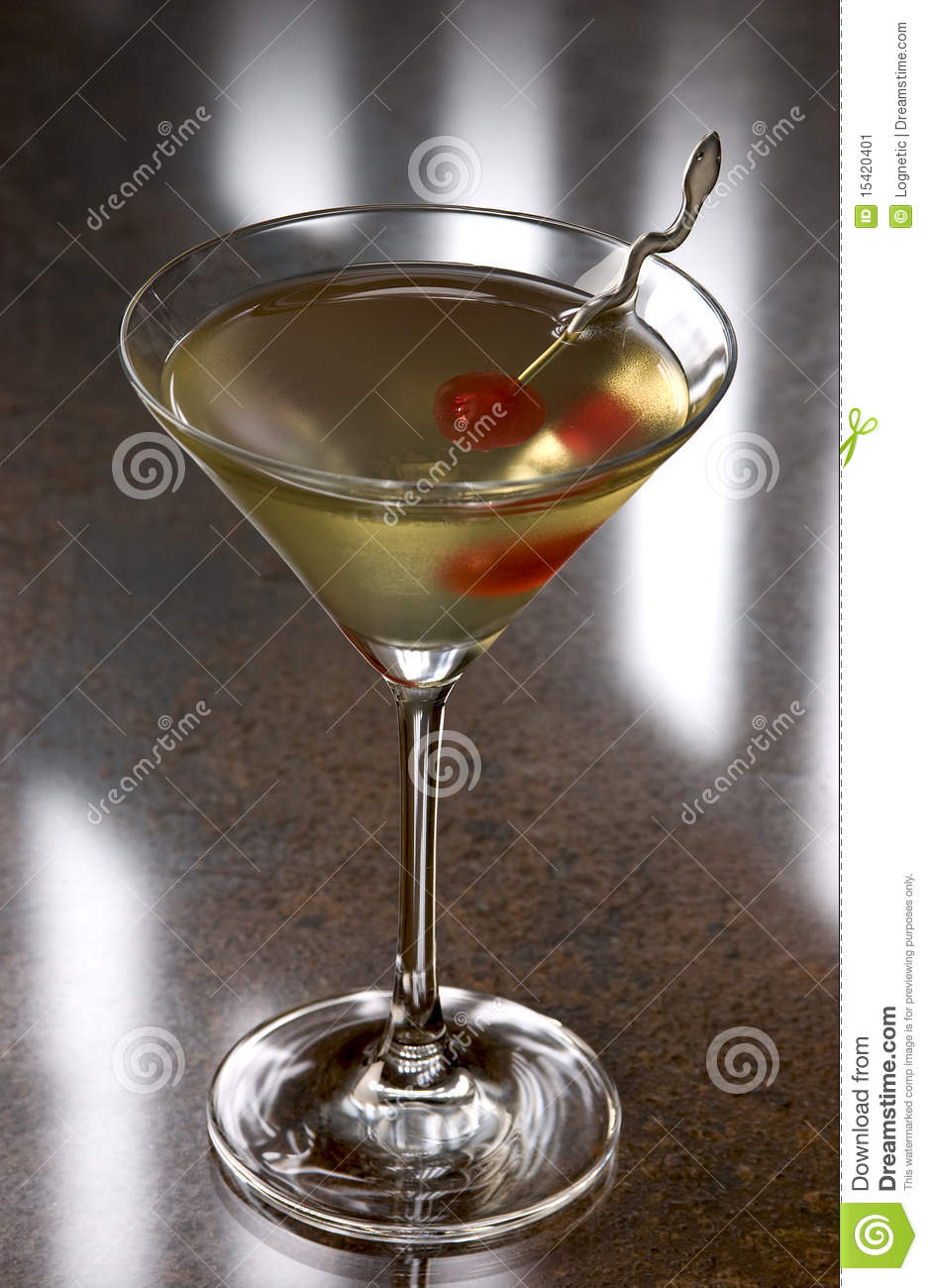 Tipperary cocktail with a cherry in a martini glass.