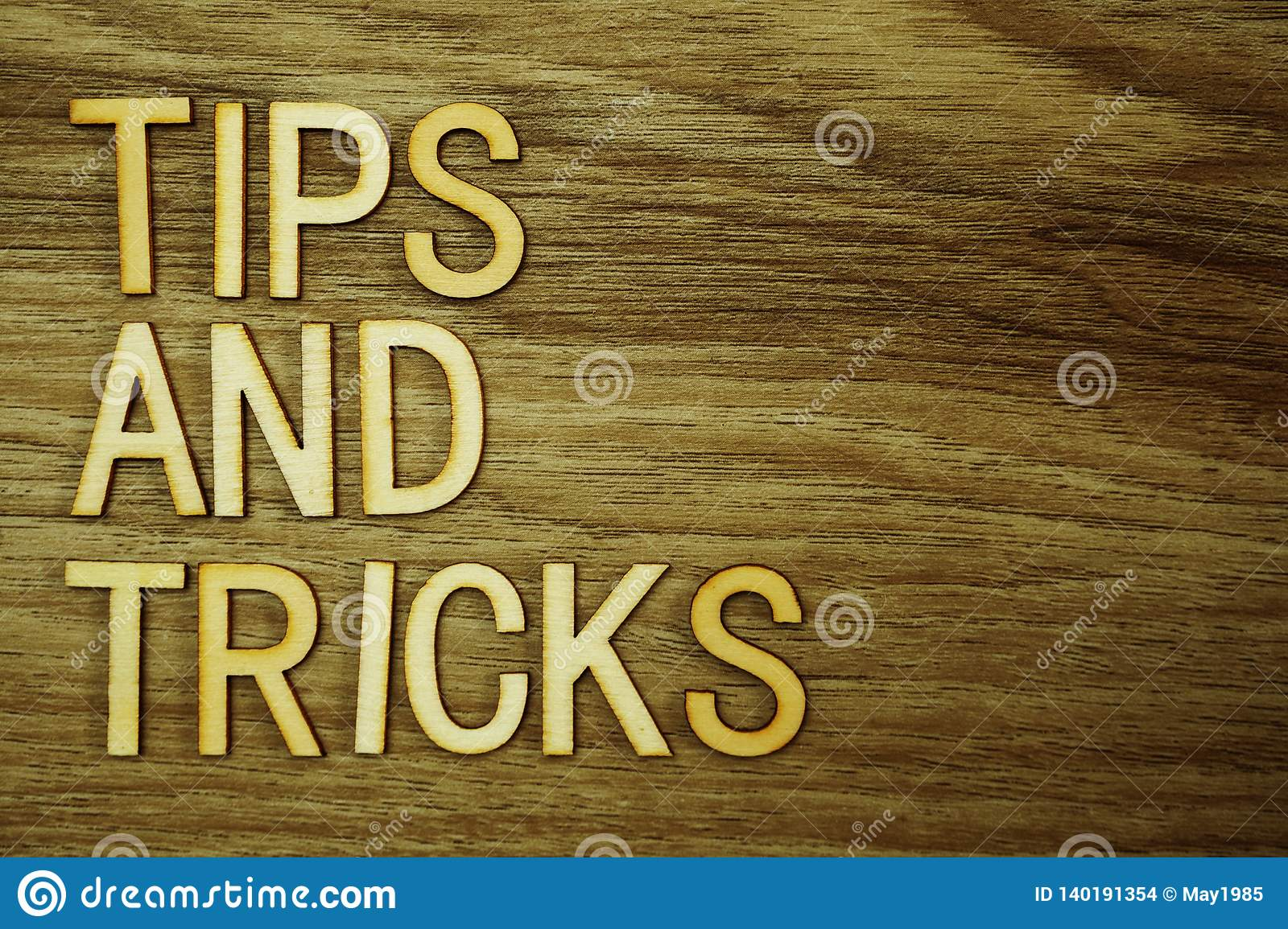Tips and Tricks text message on wooden background