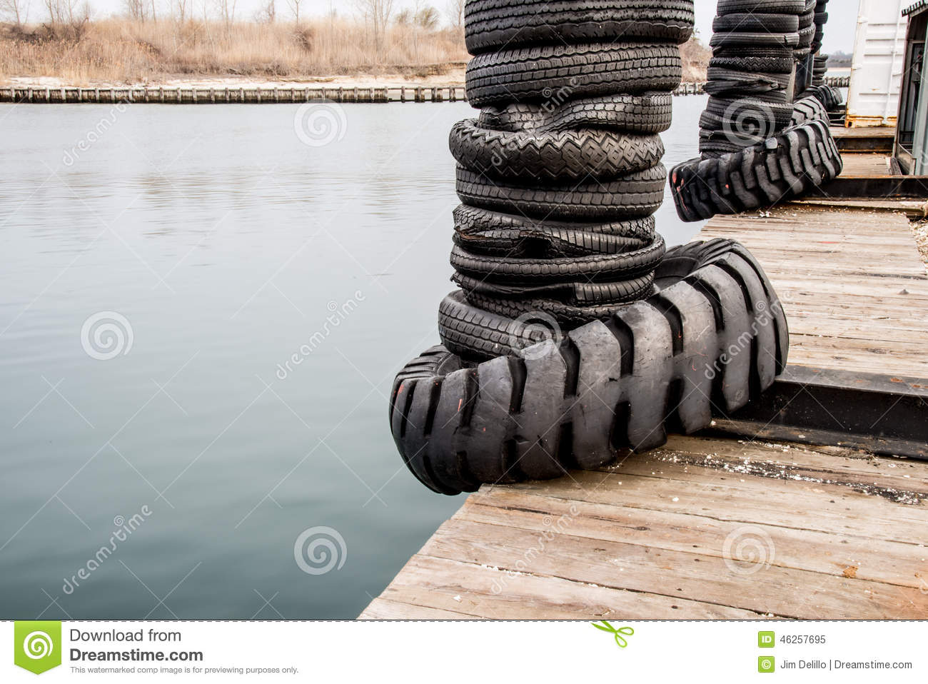 Tire bumpers on a boat dock stock photo image 46257695 for Dock pilings cost