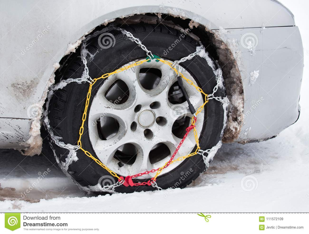 Tire chains on car in snow
