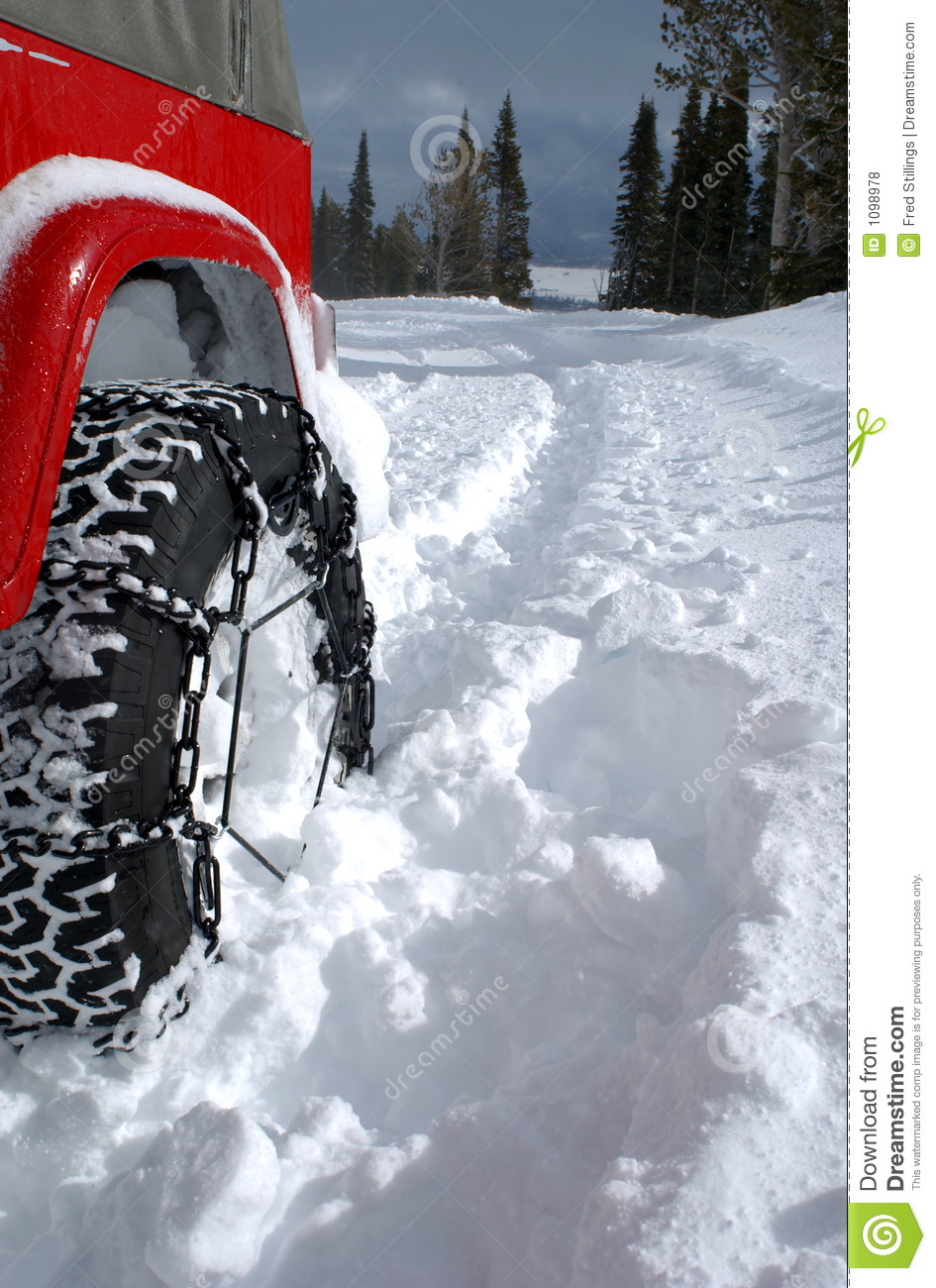 Tire In Deep Snow Royalty Free Stock Photos - Image: 1098978