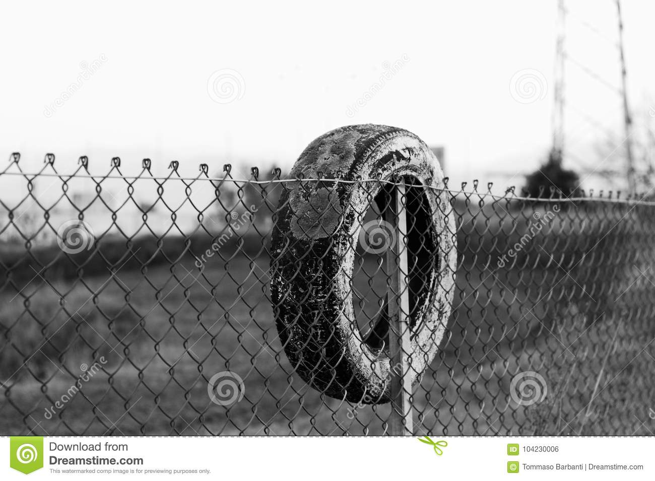 Tire On The Wire Mesh Fence Stock Photo - Image of black, design ...