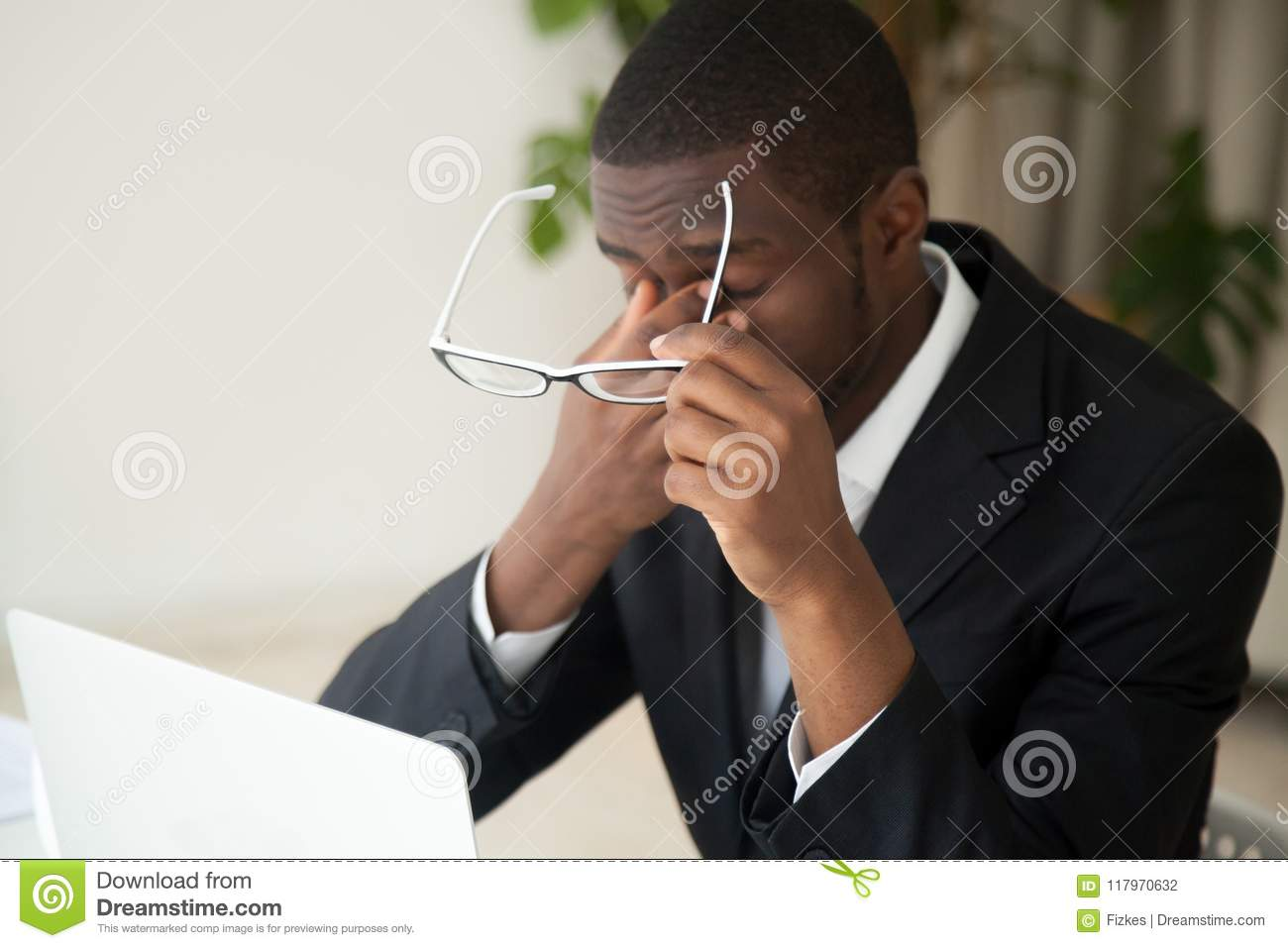Download Tired African American Exhausted From Working Long Hours Stock Photo - Image of massaging, overwork: 117970632