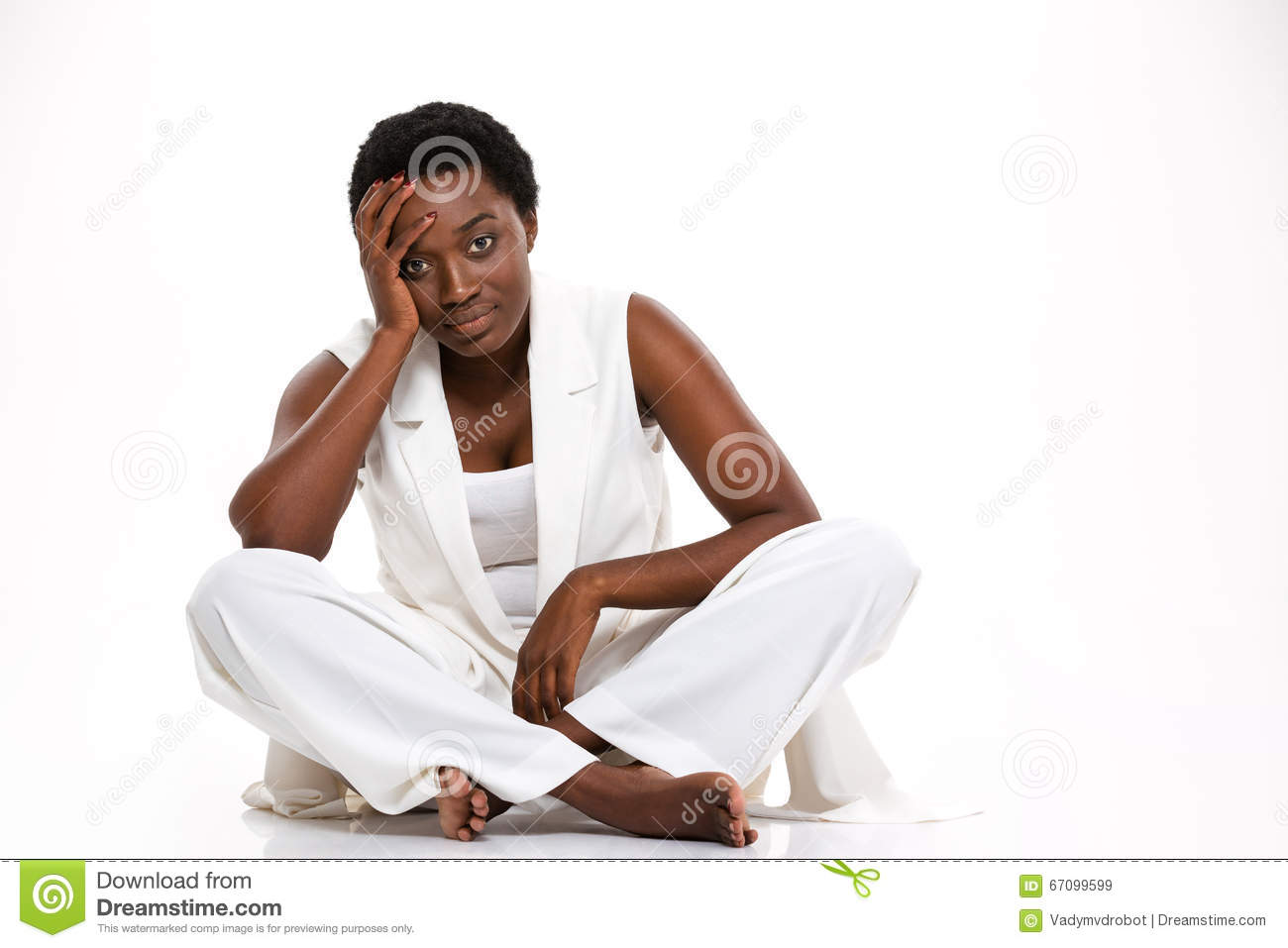 Tired african woman sitting with legs crossed and having headache