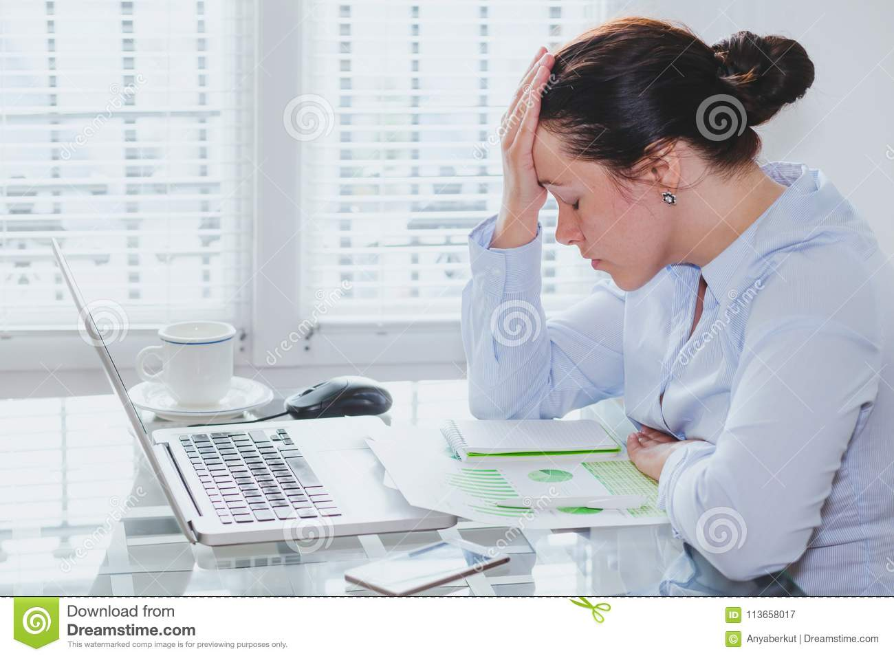 Tired business woman with computer in the office, stress and problems