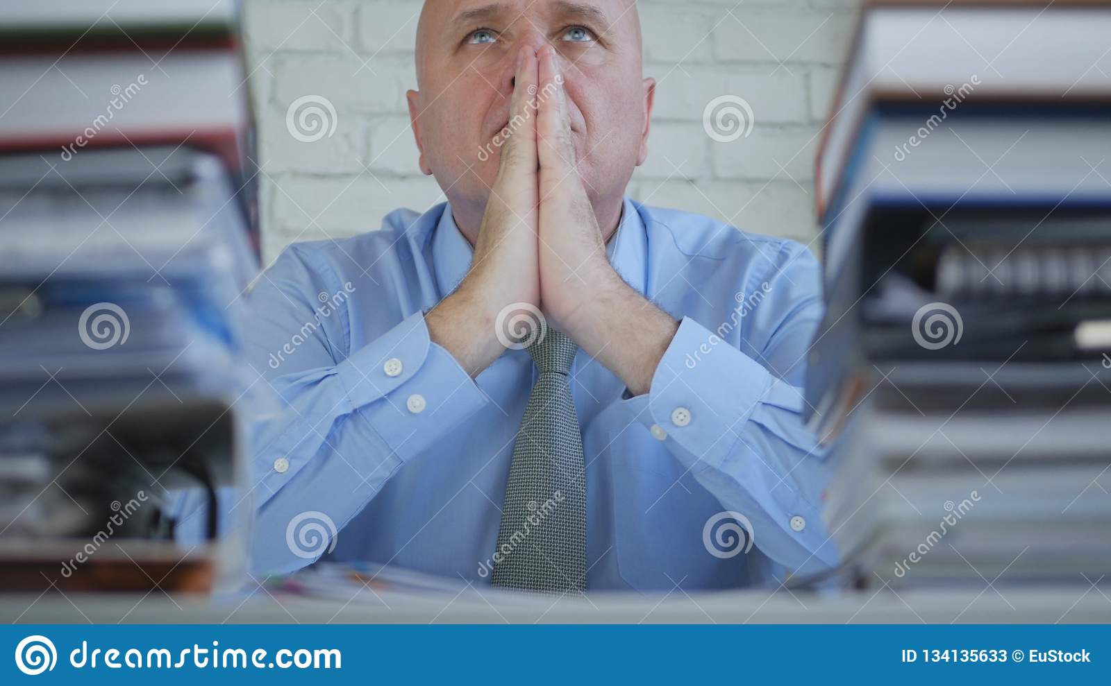Tired Businessman Worried And Troubled Make a Pray Hand Gesture
