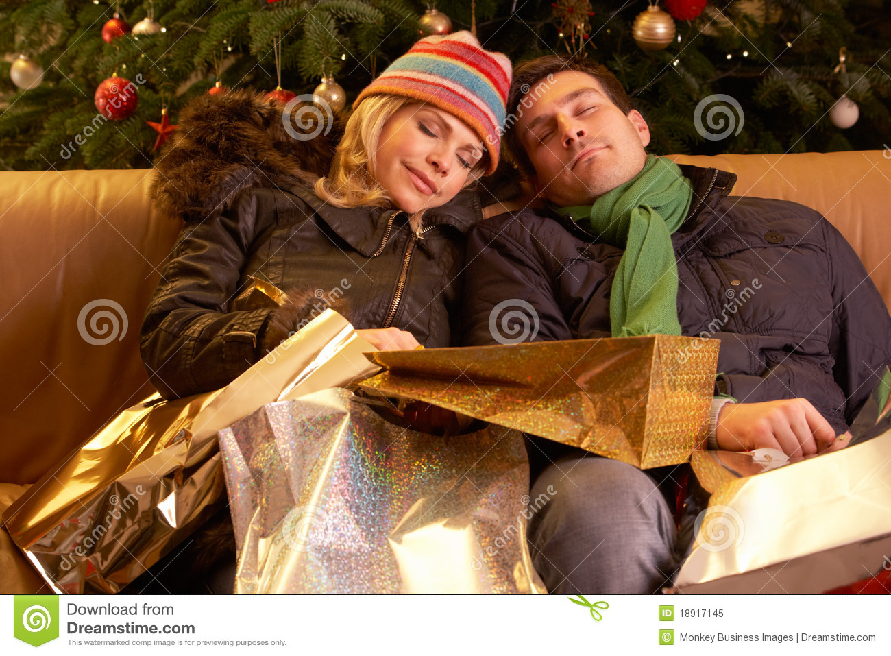 Tired Couple Returning After Christmas Shopping