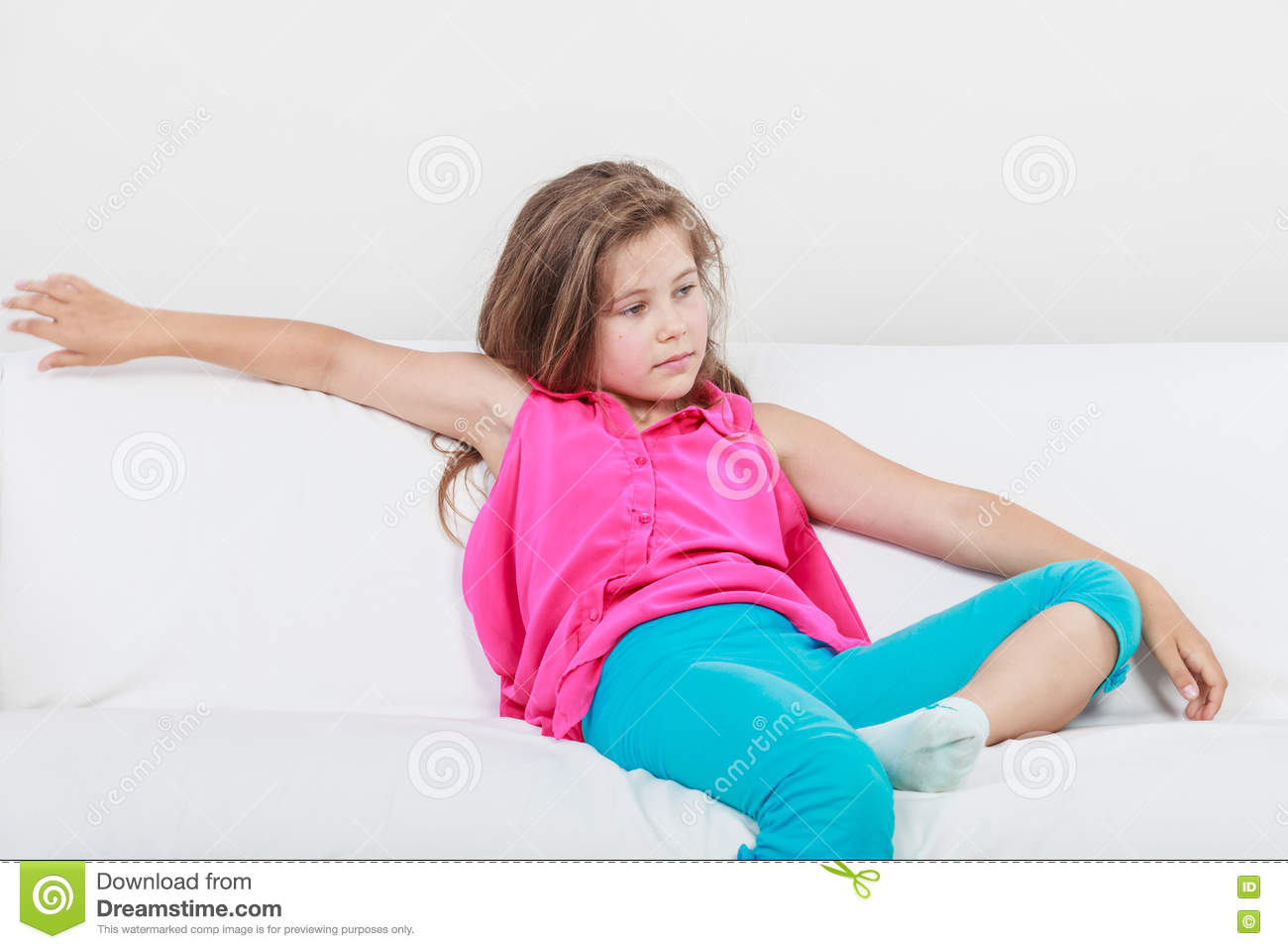 Tired Exhausted Lazy Little Girl Kid Lying On Sofa Stock