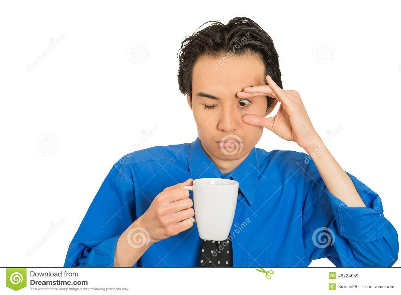 Tired falling asleep young businessman holding cup of coffee