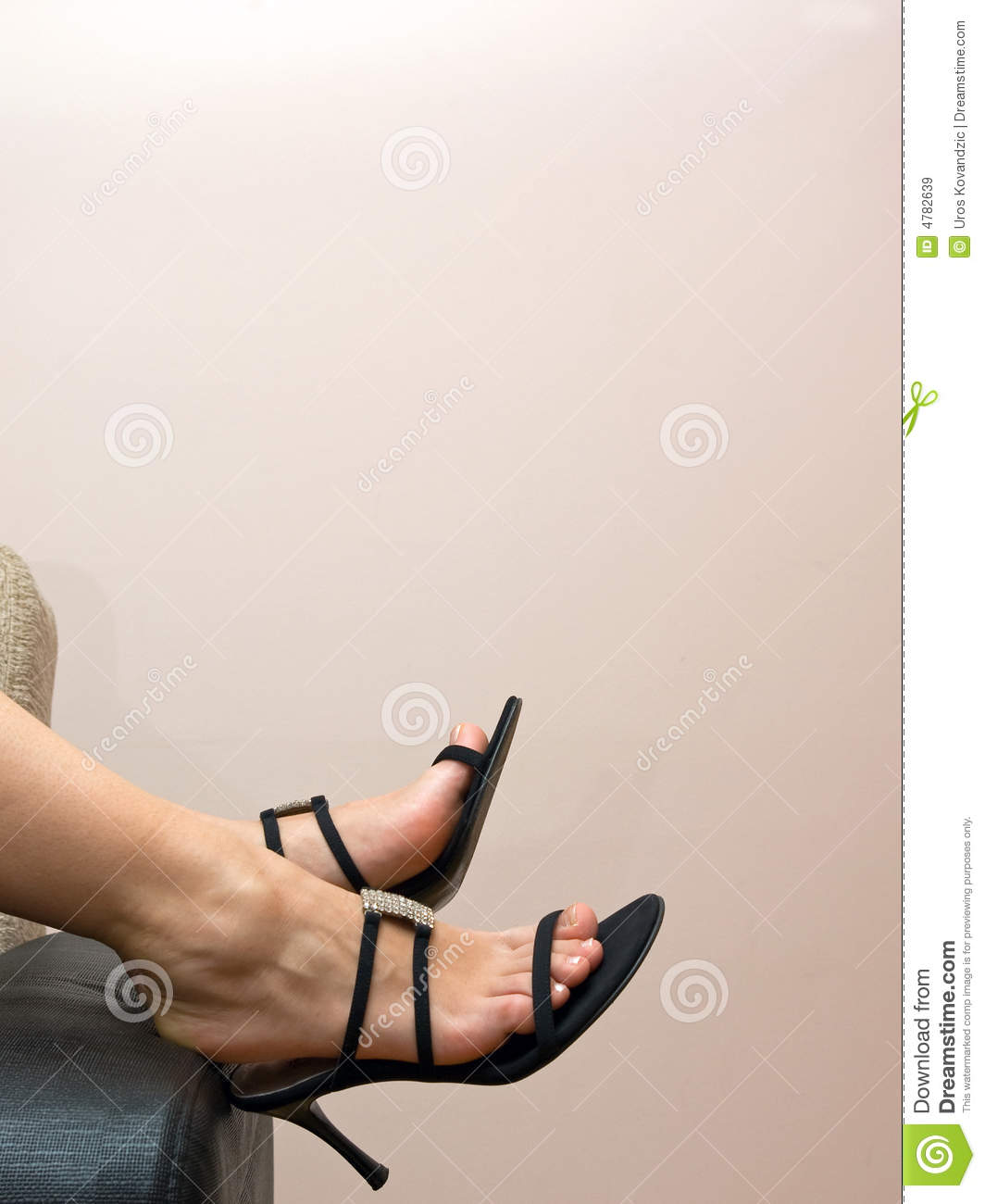 Tired Female Feet In Sandals Over A Couch Royalty Free