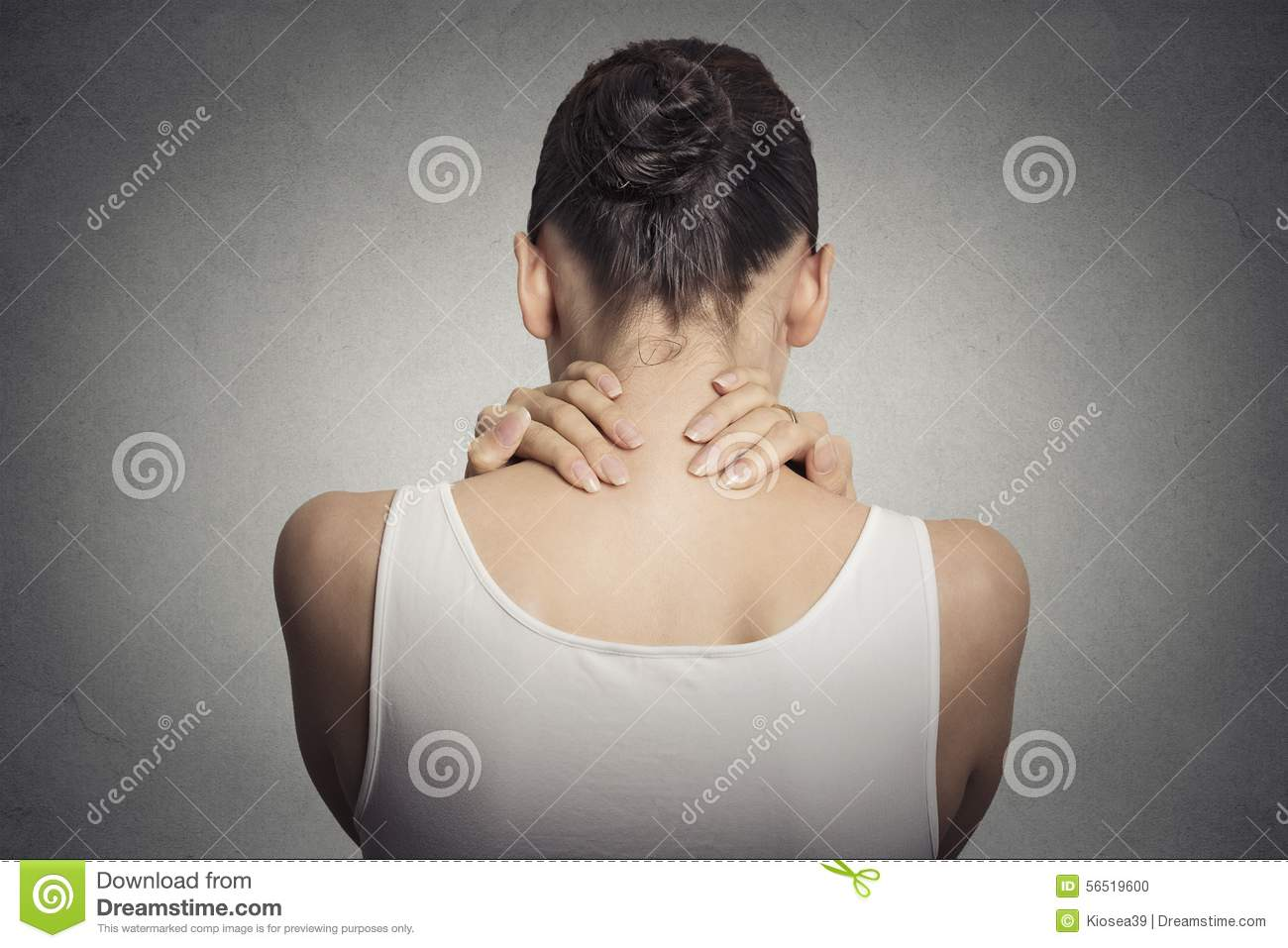Tired female massaging her painful neck