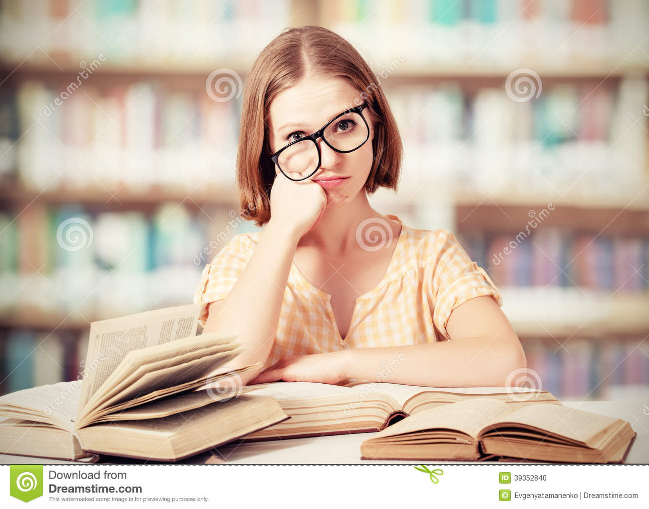 Tired Funny Girl Student With Glasses Reading Books Stock ...