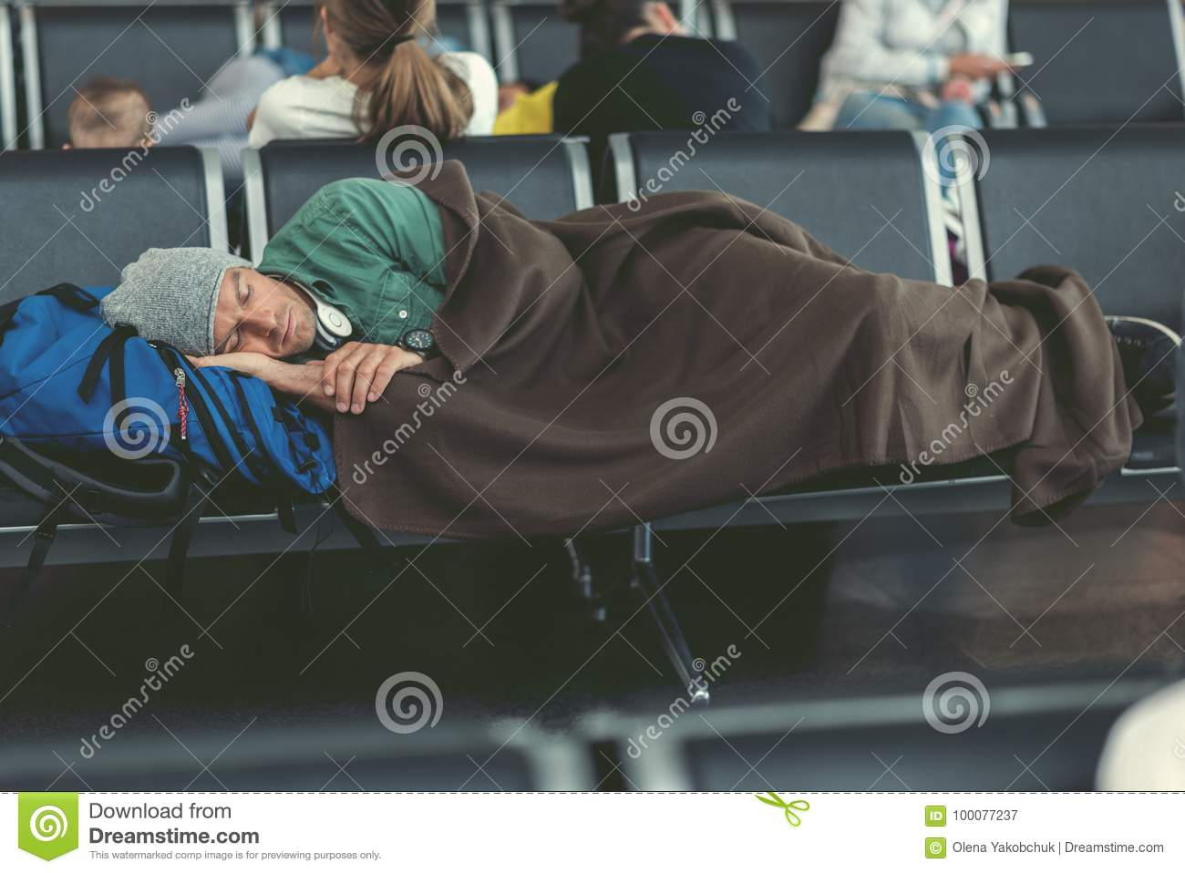 Tired guy is sleeping in airport lounge