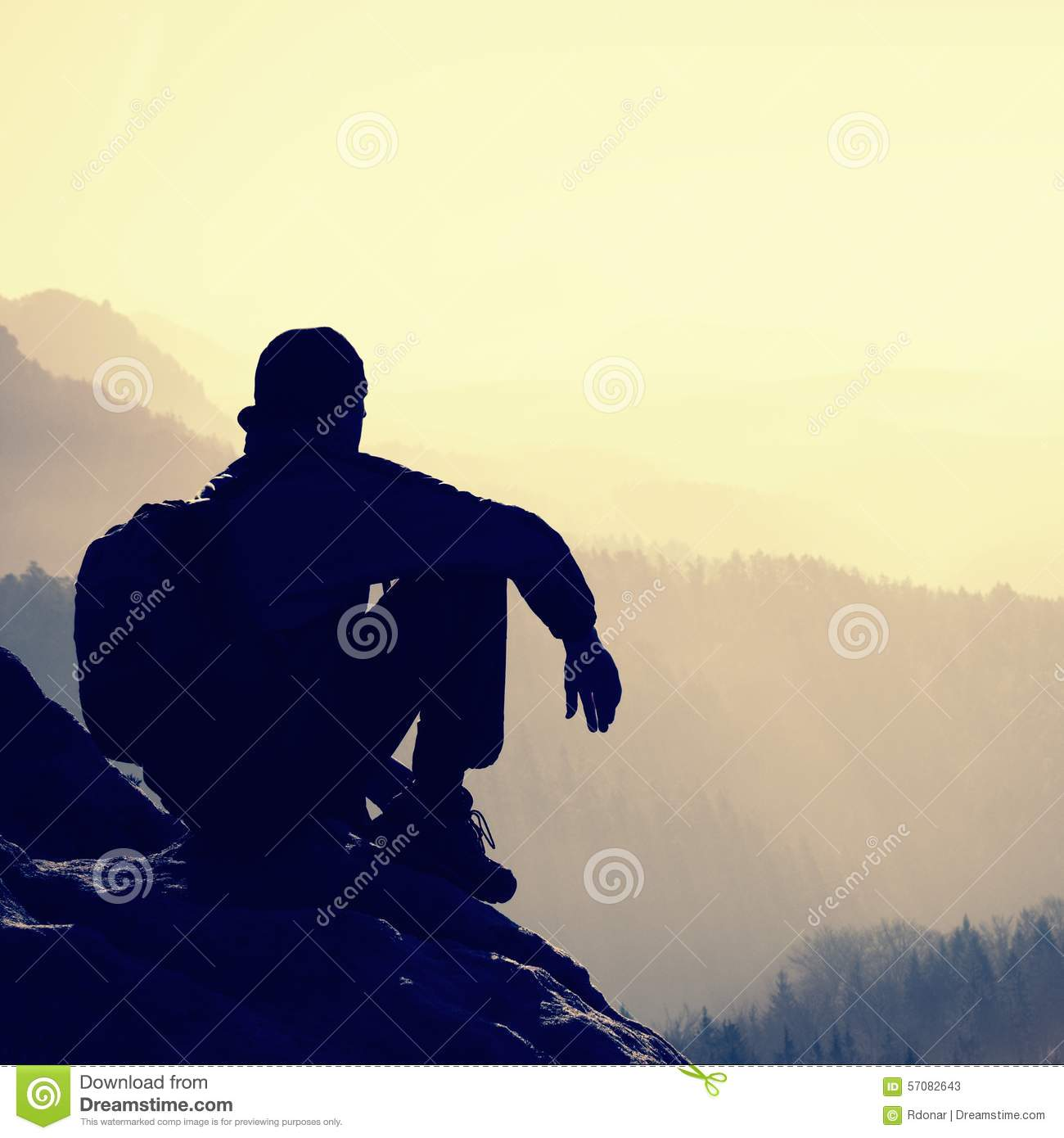 Tired Hiker Relaxes On A Slope In The Mountains Stock ...
