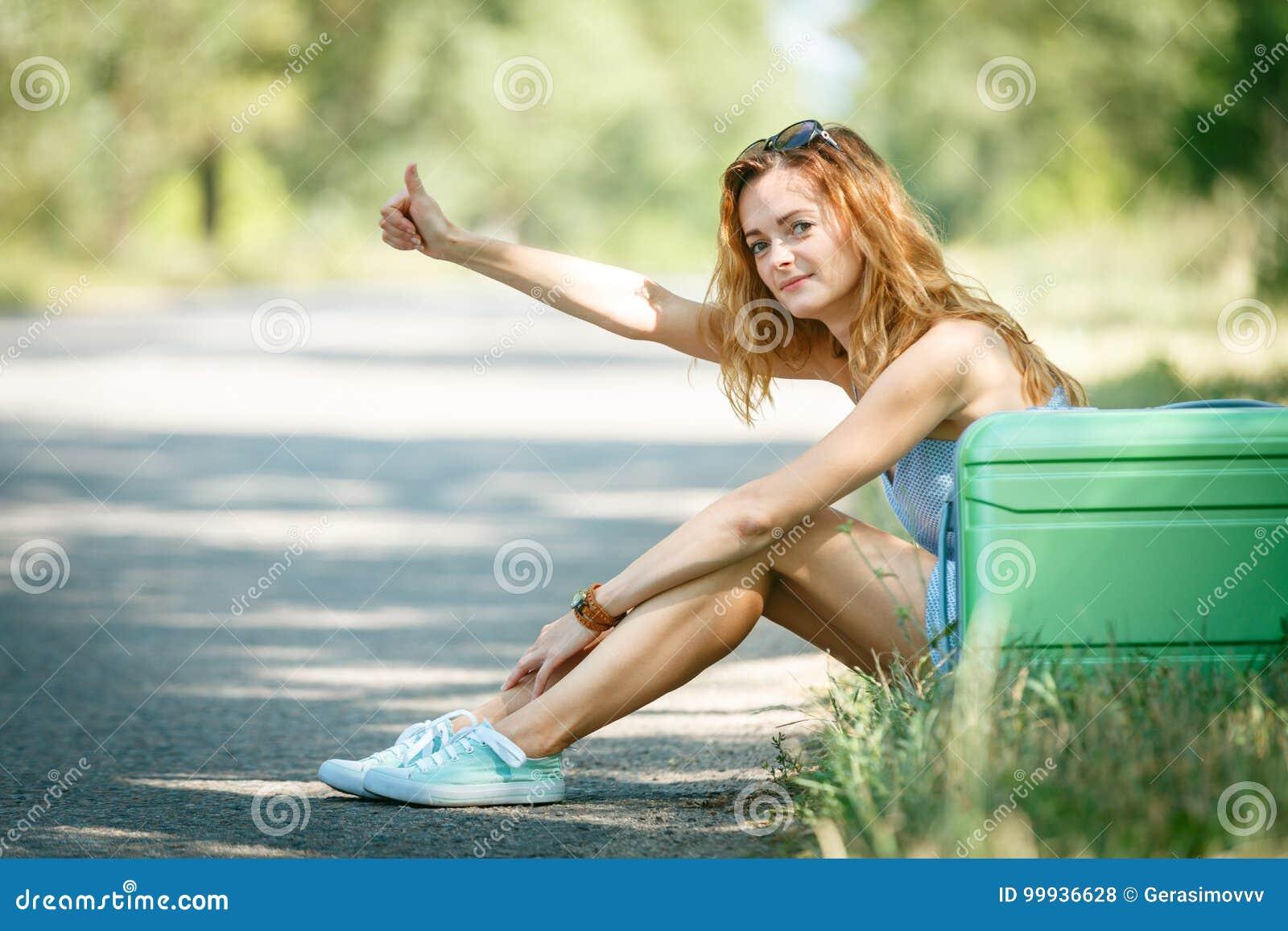 Tired Hitchhiking girl