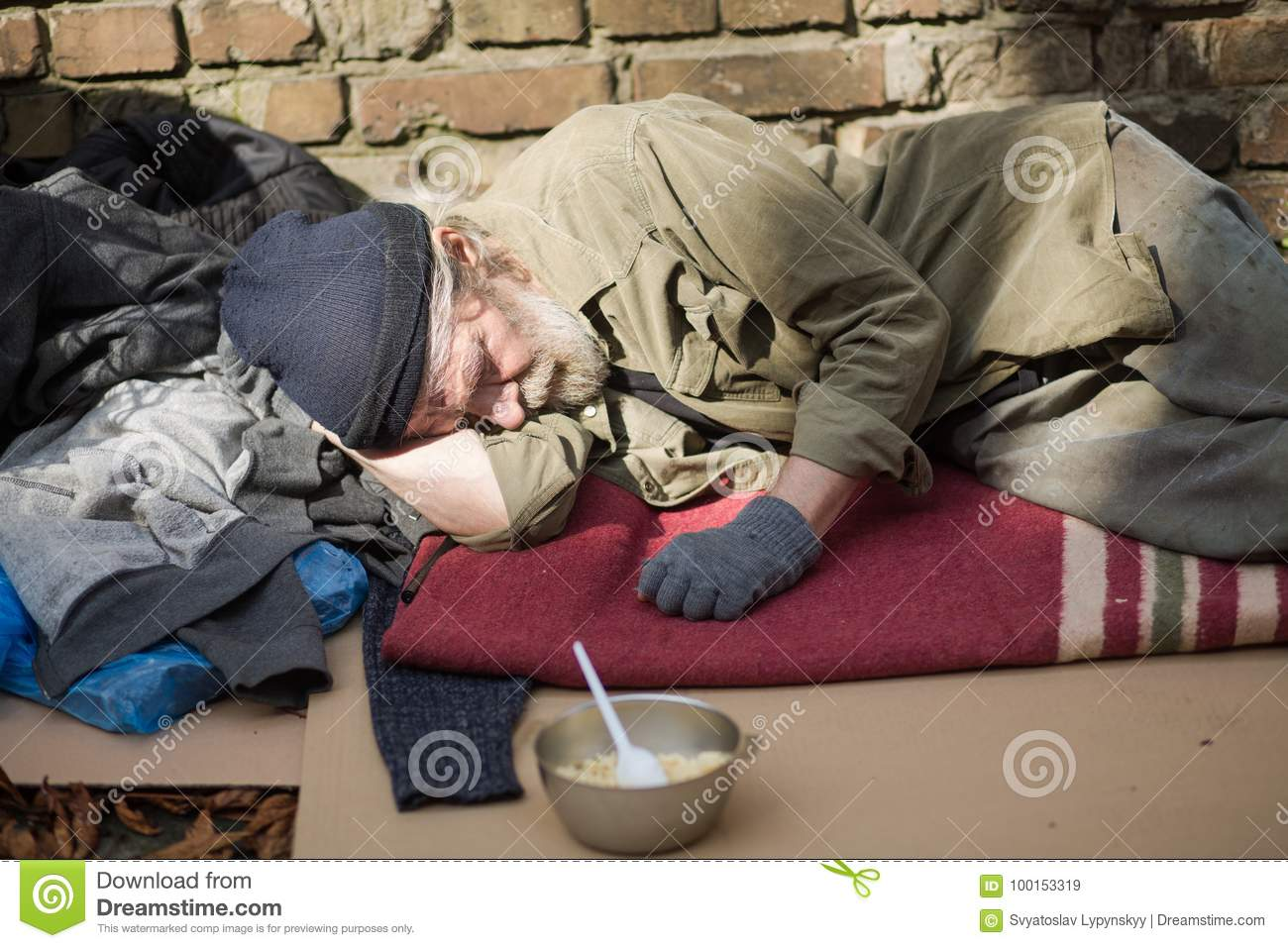 3ae5e05d13 Tired Homeless Old Man Sleeping On Cardboard In The Street. Stock ...