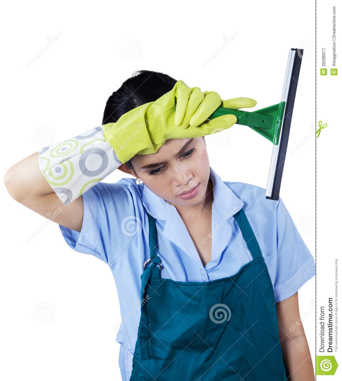 tired maid holding cleaning tool stock photo