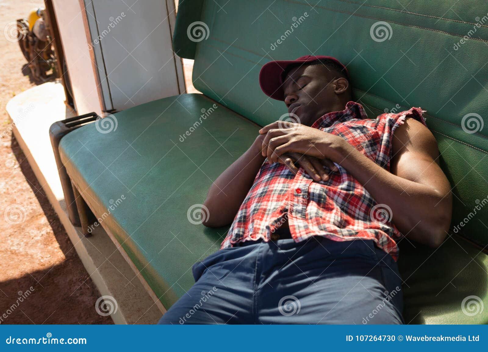 Man sleeping at petrol pump station