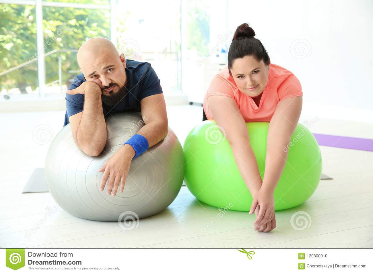 Tired overweight man and woman resting stock photo image of