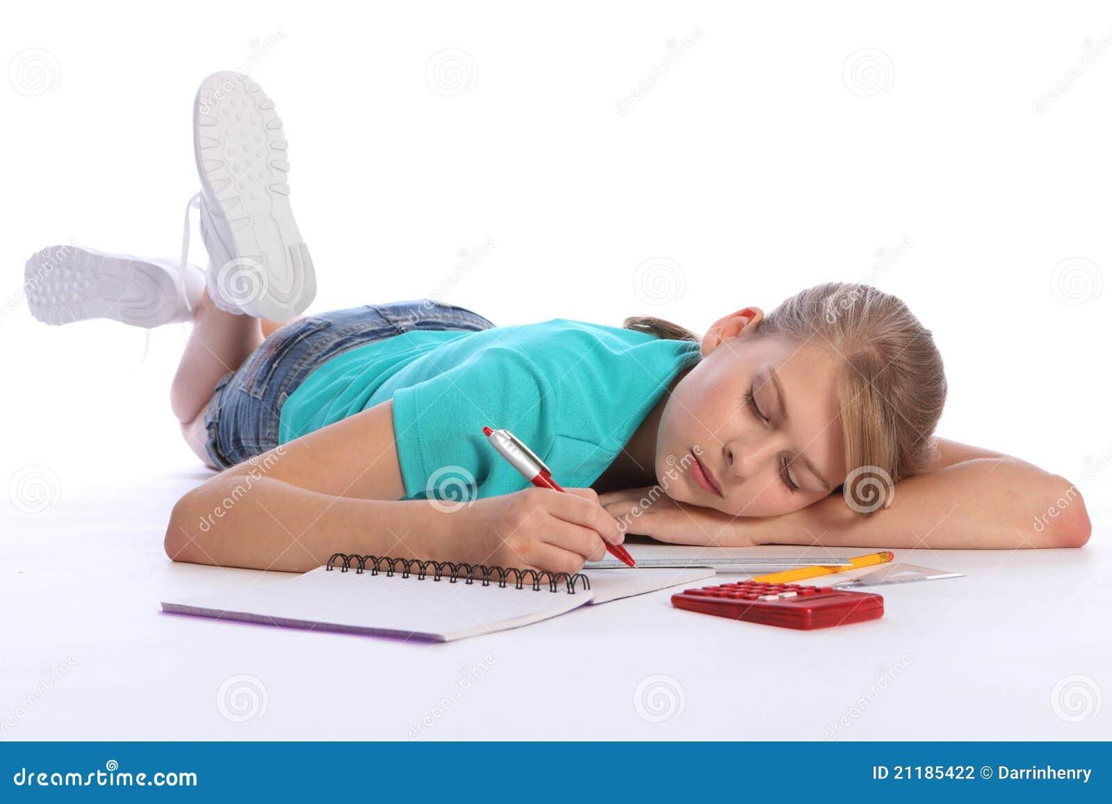 Tired school girl falls asleep doing math homework