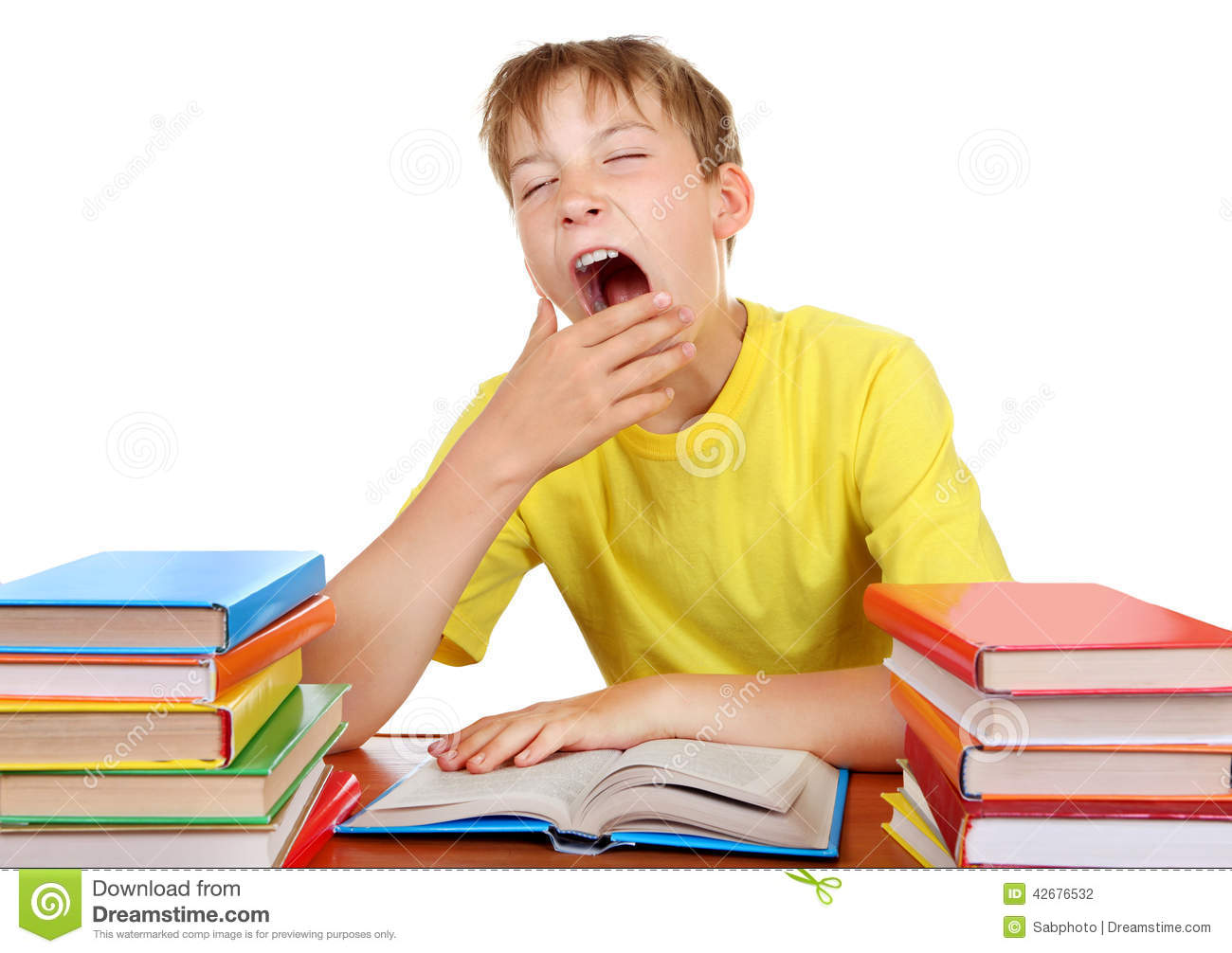 ... Kid Yawning at the School Desk with a Books on the white background