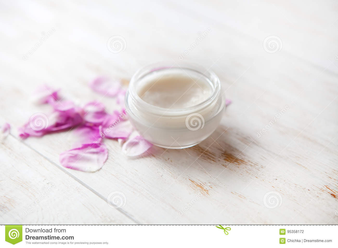 Tired skin cosmetic cream facial skincare medical treatment therapy .face cream with rose petals on white background