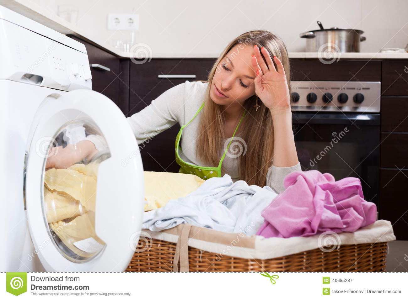 tired woman doing laundry stock image  image of person