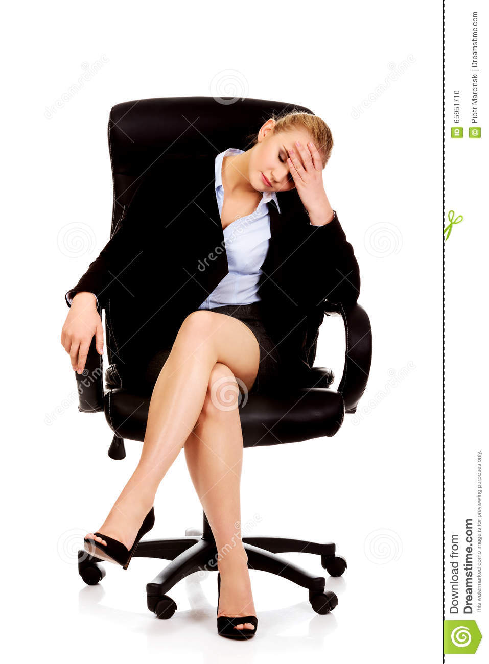 Tired or worried business woman sitting on armchair stock for Sitting in armchair