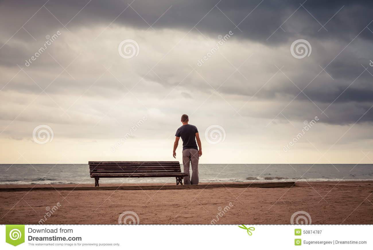 tired young man goes to the old wooden bench stock image image 50874787. Black Bedroom Furniture Sets. Home Design Ideas