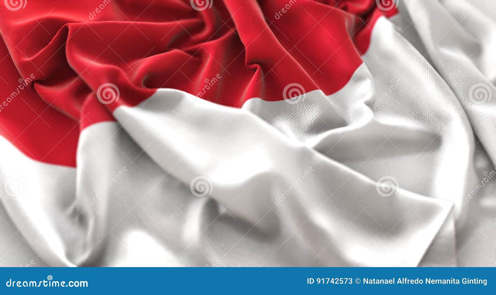 Tiro macro belamente de ondulação enrugado do close-up da bandeira de Mônaco