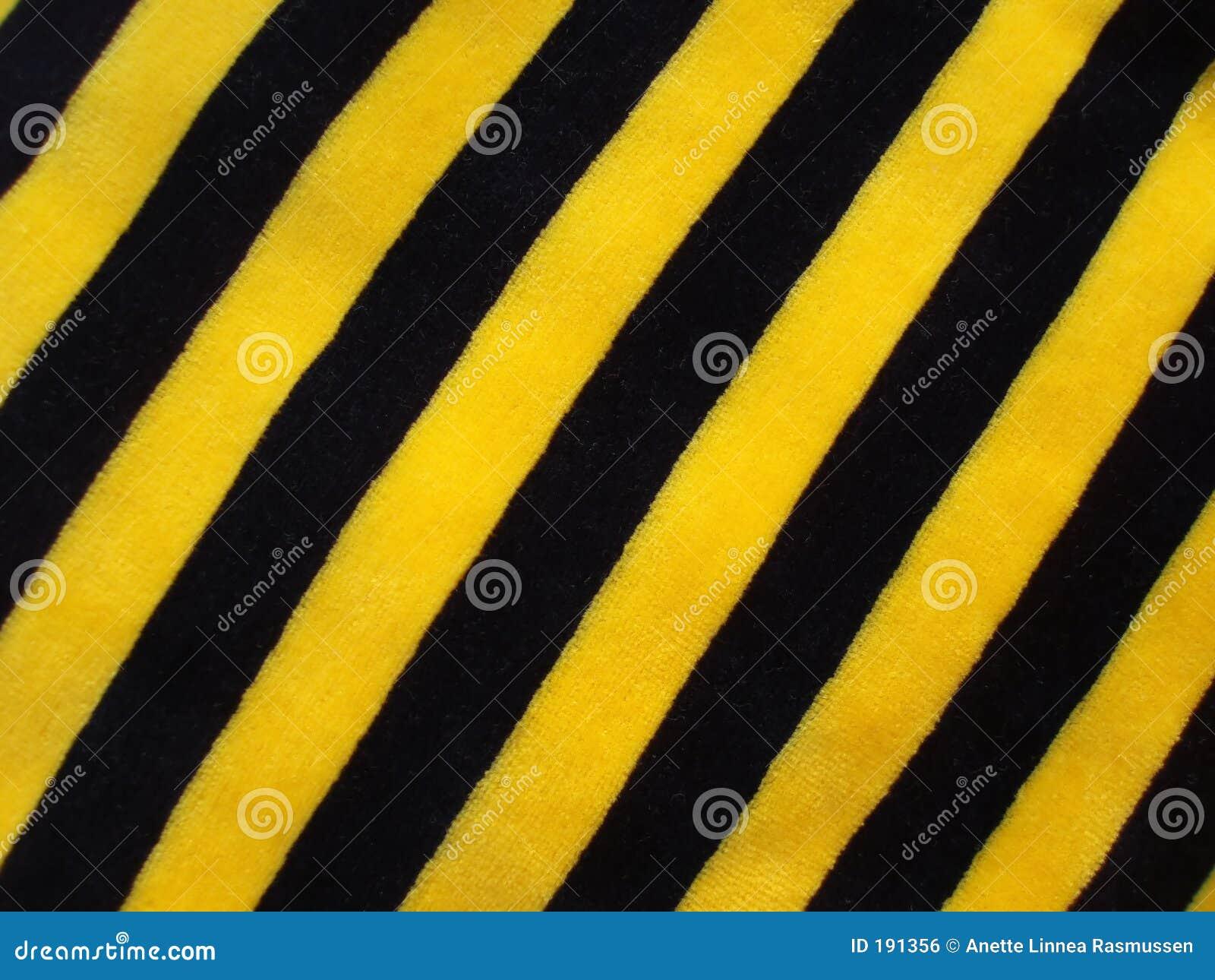 Tissu rayé noir et jaune