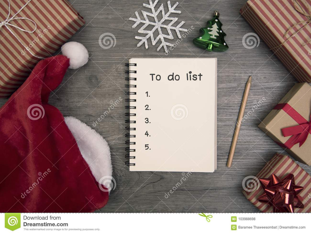 to do list for start christmas and decorated with gift box on wooden table