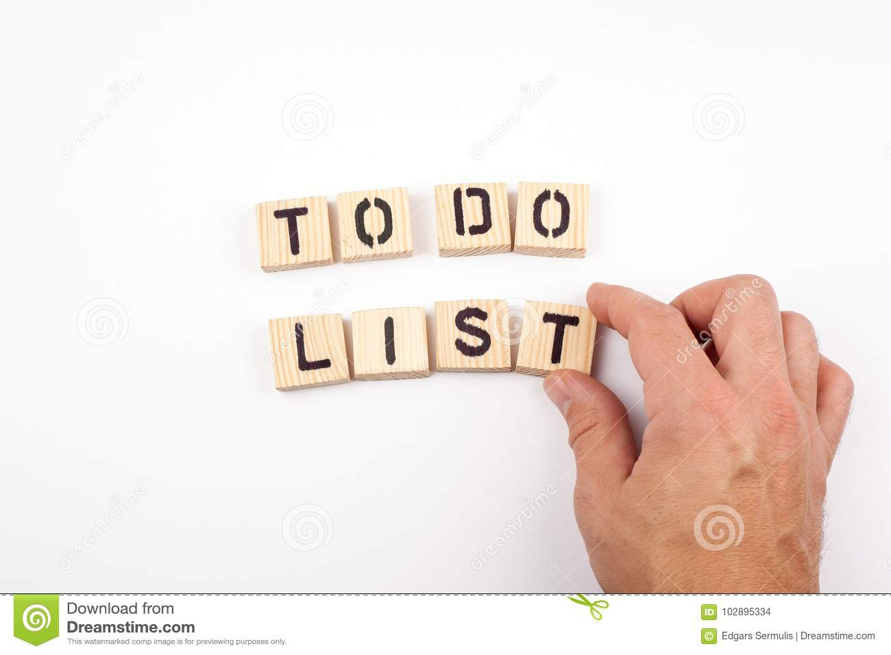 To do list. Wooden letters on a white background