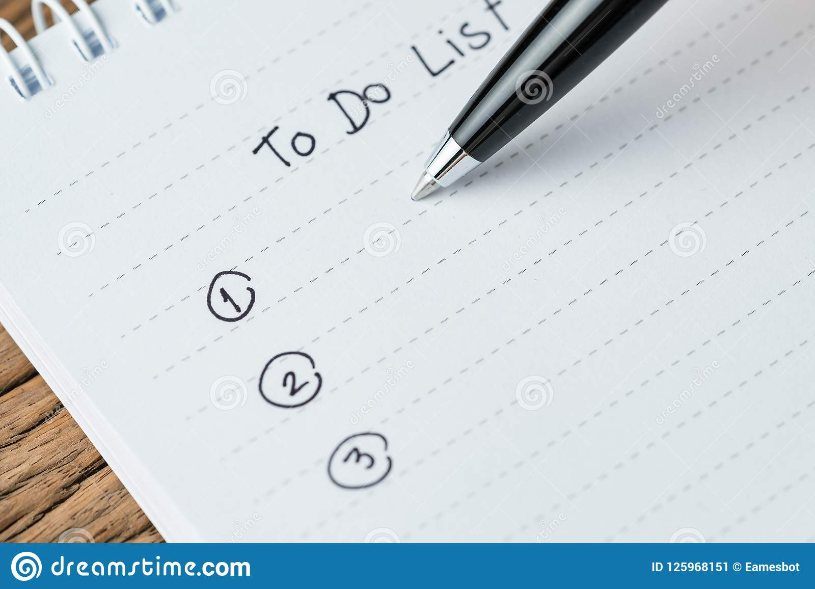 to do list or writing tasks priority concept close up of list o