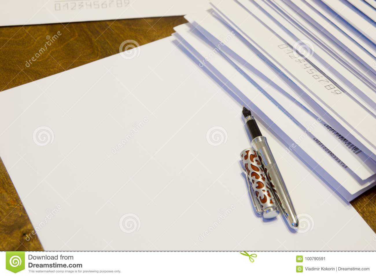 To write a letter on paper. A stack of letters in paper envelopes.