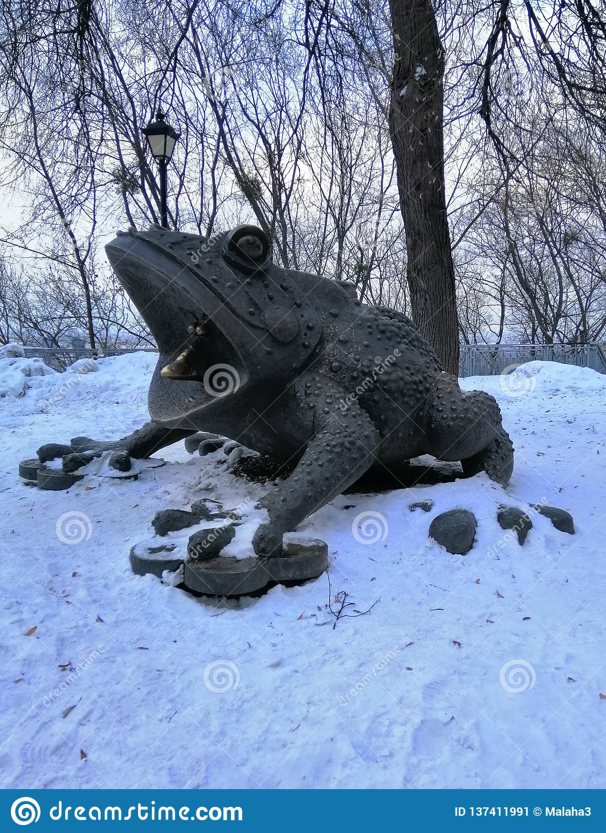 Toad - decoration of the city park in winter