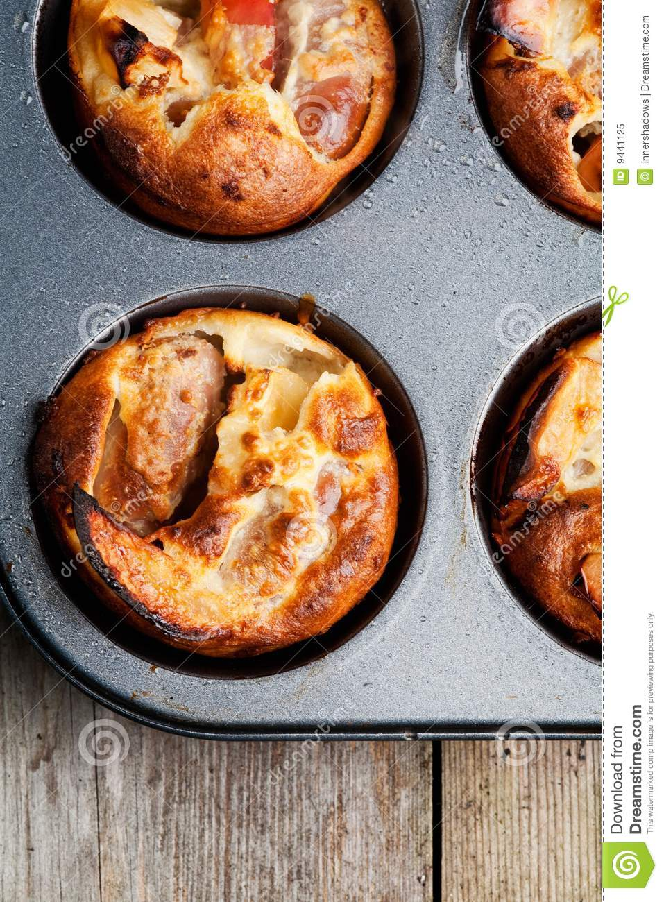cooked Toad in the Hole with apples. A traditional English ...