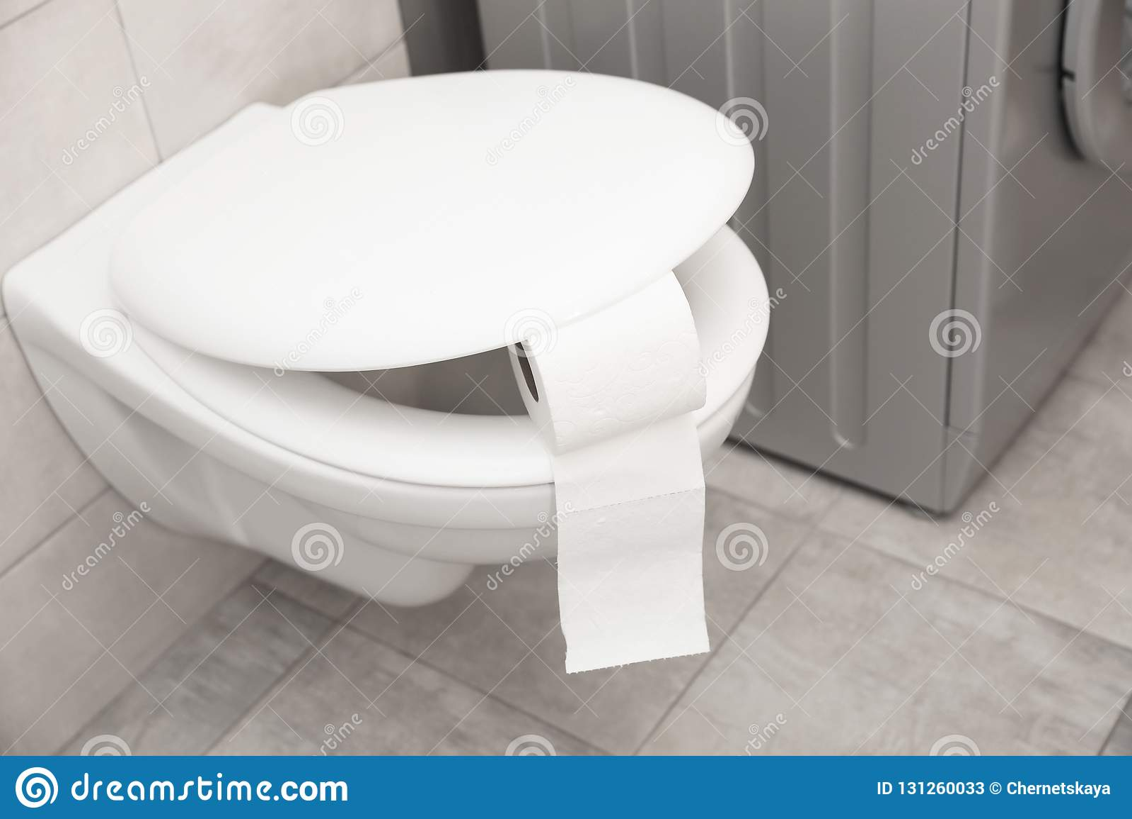 Toalettbunke med pappers- rulle