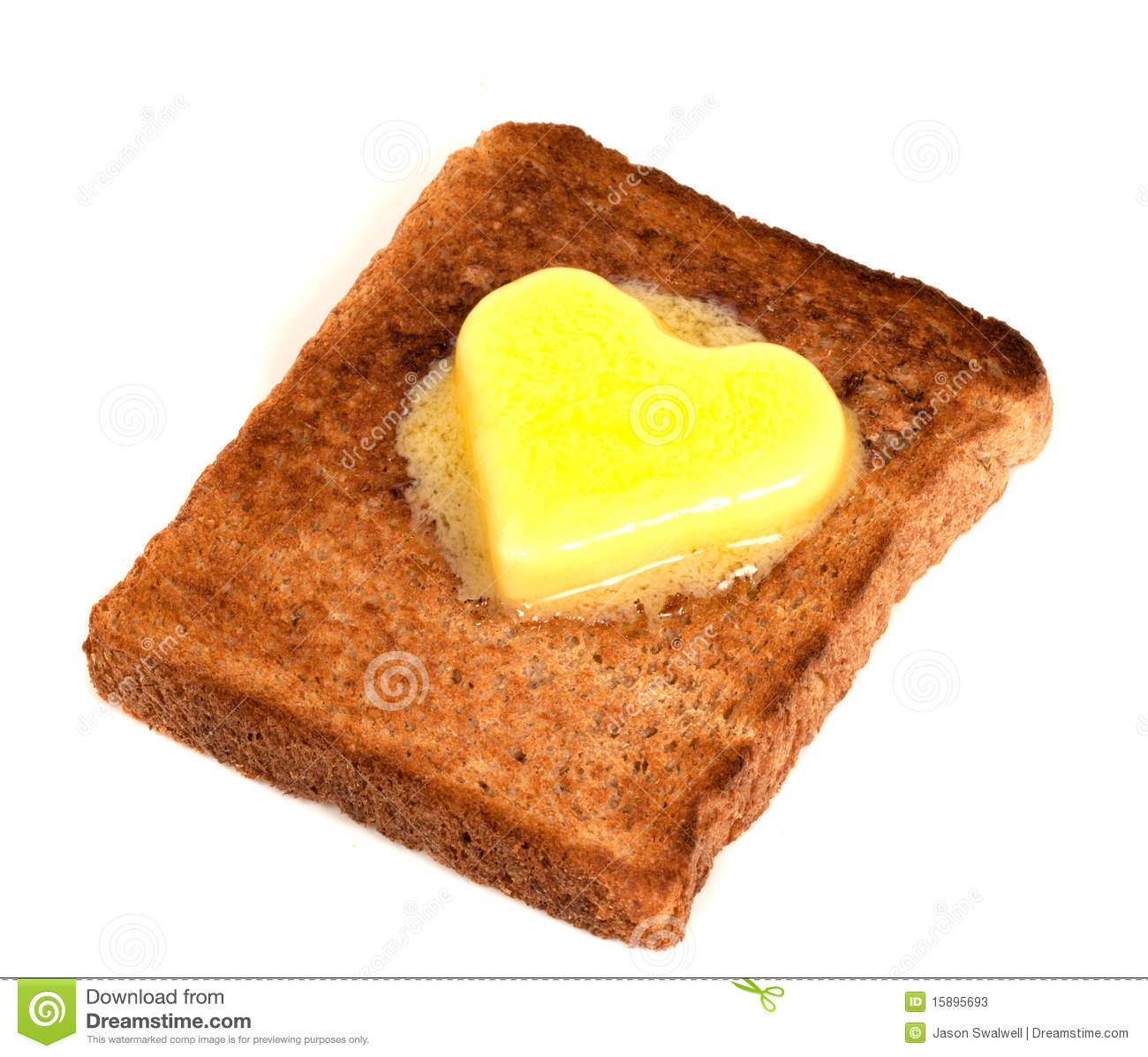 Melting Heart Shaped Butter on wholemeal Toast on white background.