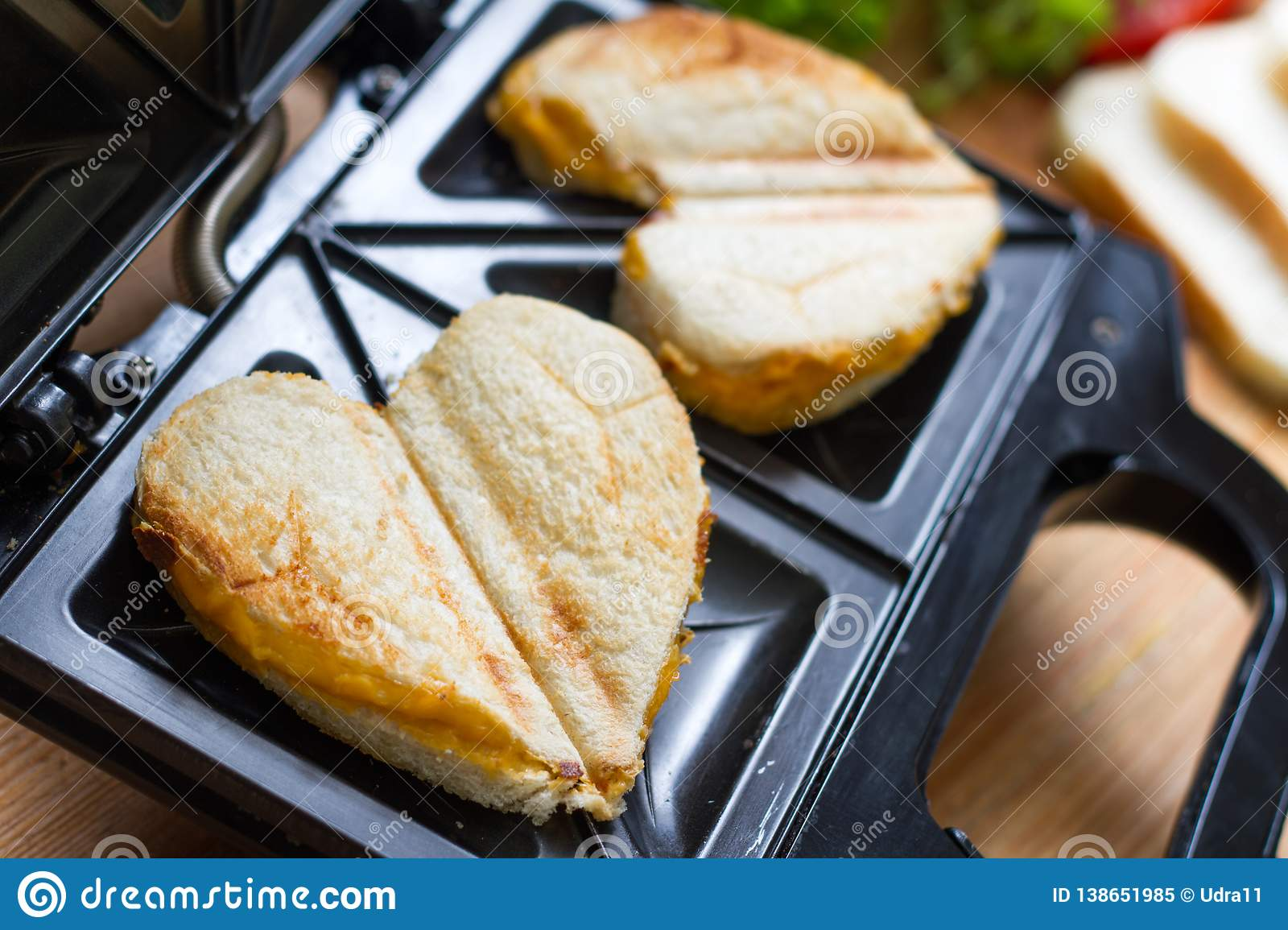 Toast heart shape with toaster sandwich maker love valentines breakfast concept