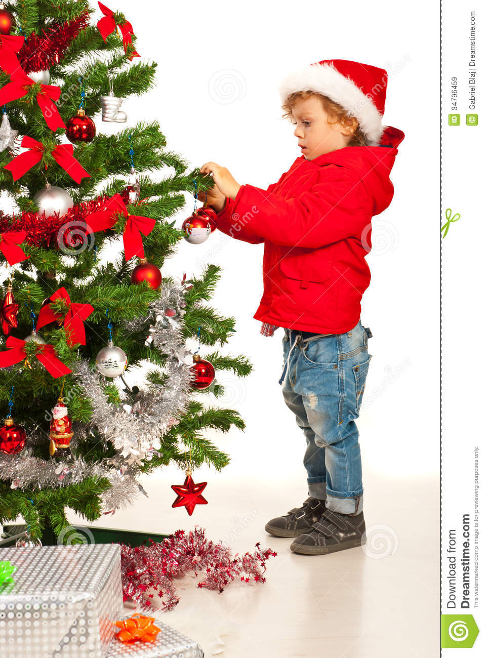 Toddler boy decorate xmas tree stock image image 34796459 for Decorate pictures
