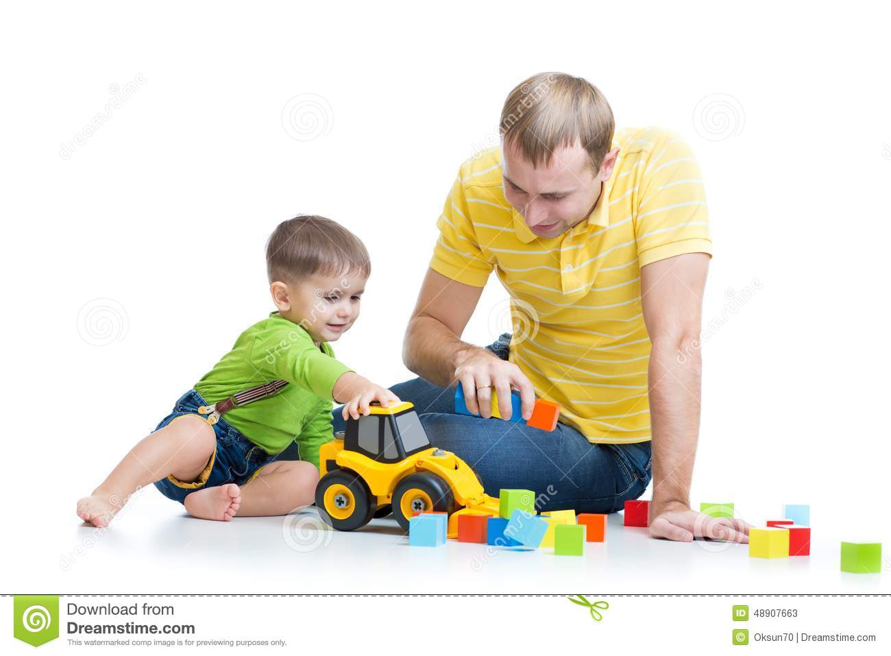 Boy Toys For Dads : Toddler boy and his father repair toy tractor stock photo