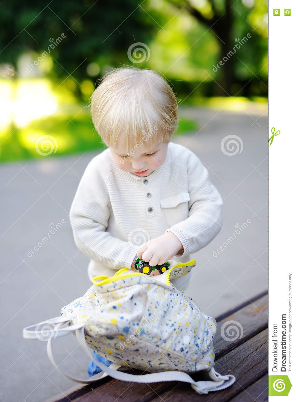 Toddler Boy Putting Toys In Backpack Stock Image - Image of
