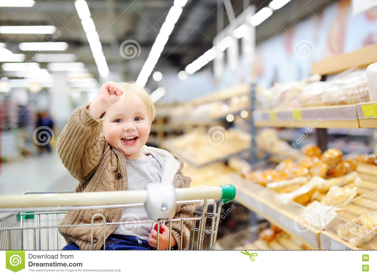 6ad9550a8 Toddler Boy Sitting In The Shopping Cart In A Supermarket Stock ...