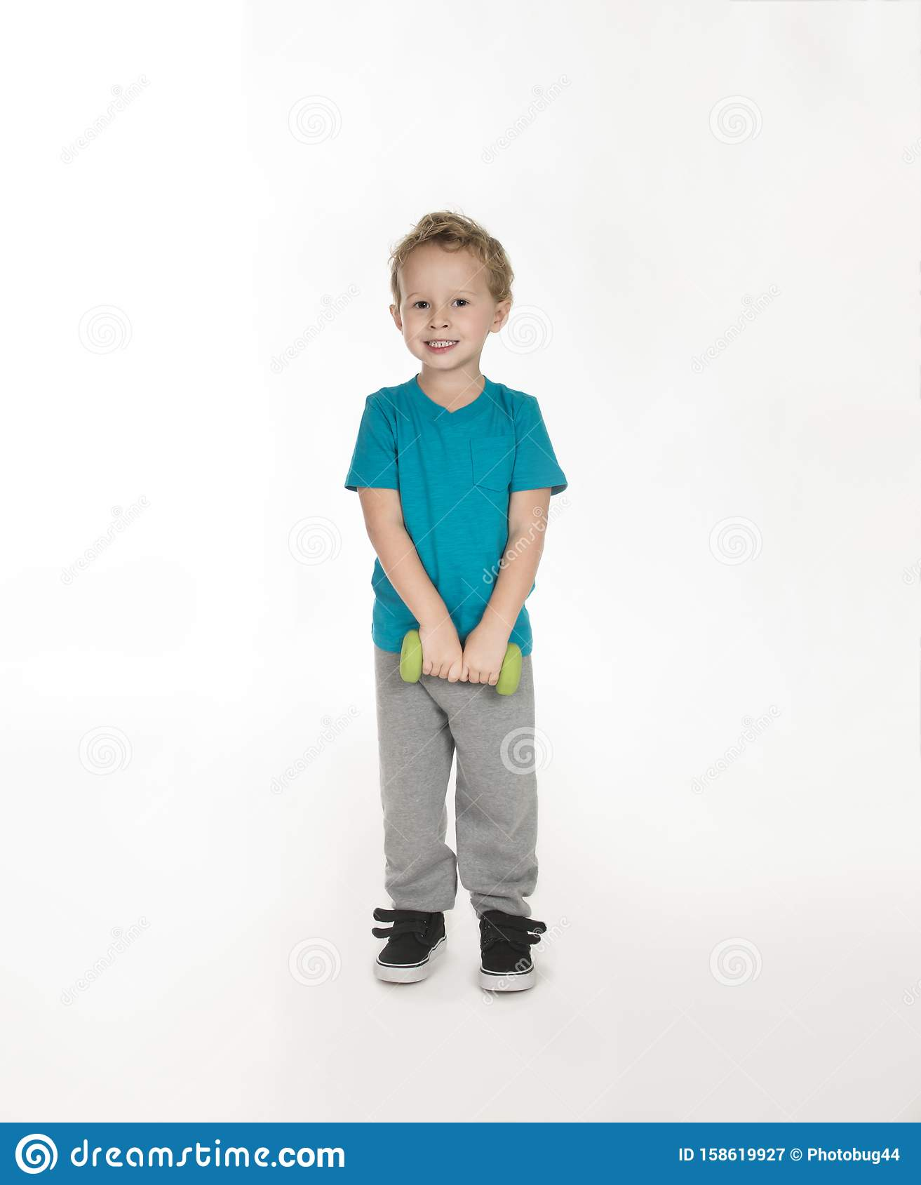 Toddler Boy Standing With Small Hand Weight Stock Image