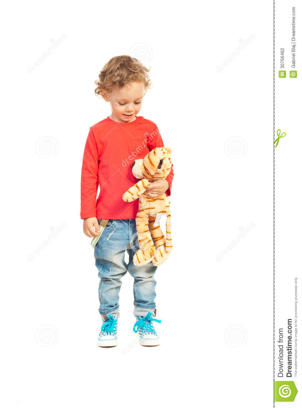 Boy Toys Background : Toddler boy talking with tiger toy stock photography