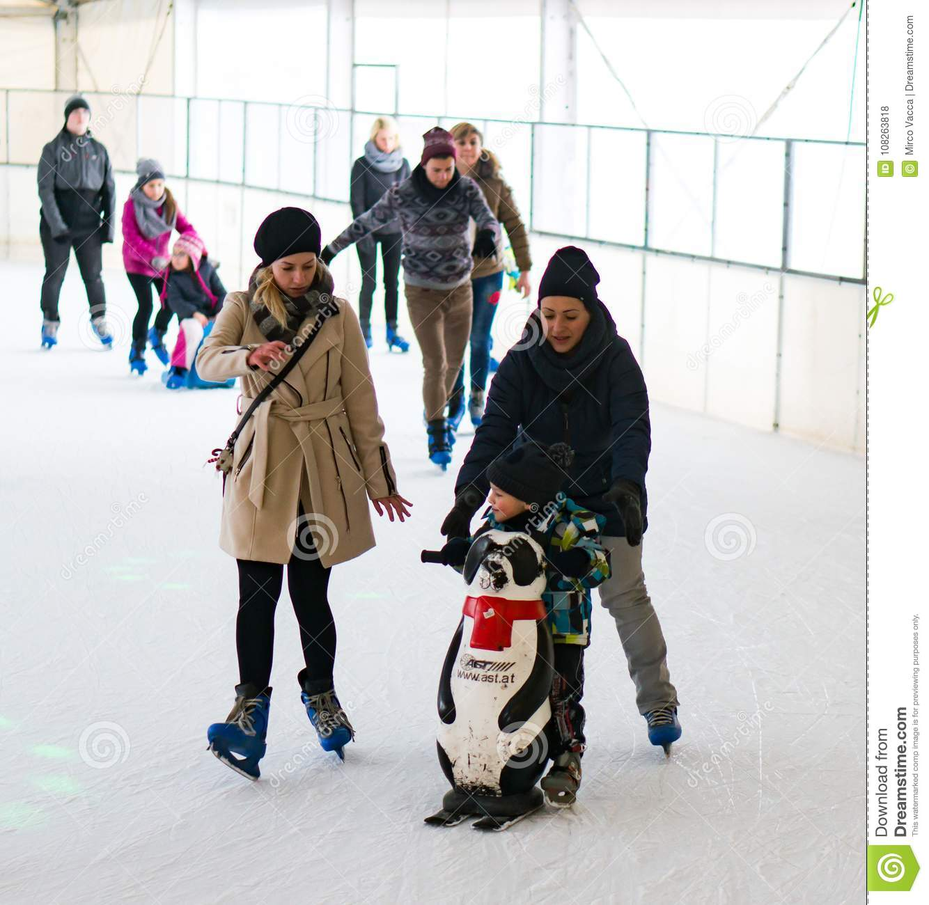 Toddler boy and two women skating on ice on circa January 2018 in Poznan a37dc2aef8