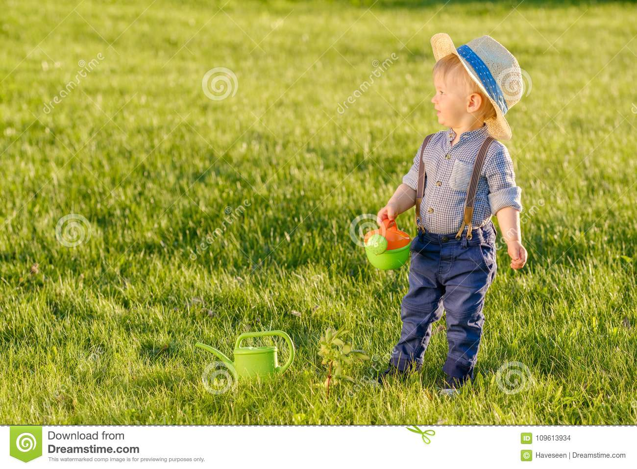 Toddler Child Outdoors. One Year Old Baby Boy Wearing Straw Hat ... 56a838ef97b